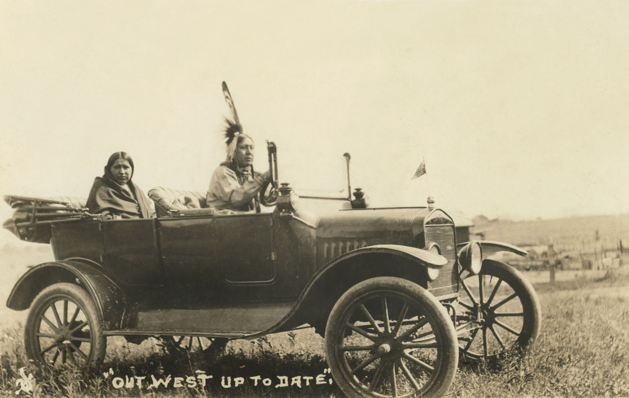 Osage Native American driving a rolls royce