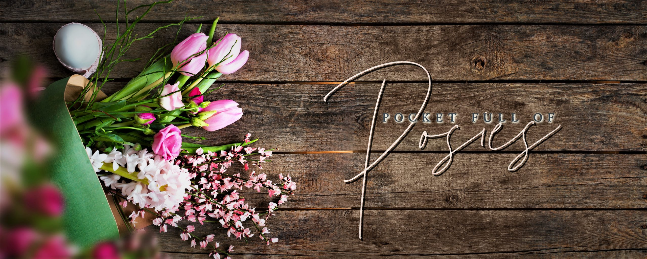 pink flowers on barn wood sign